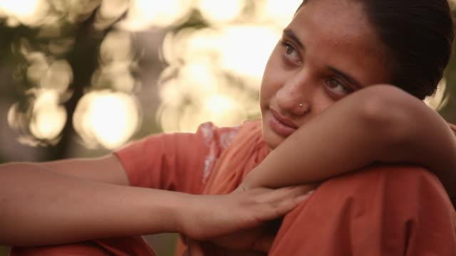Close-up of a girl thinking, Faridabad, Haryana, India