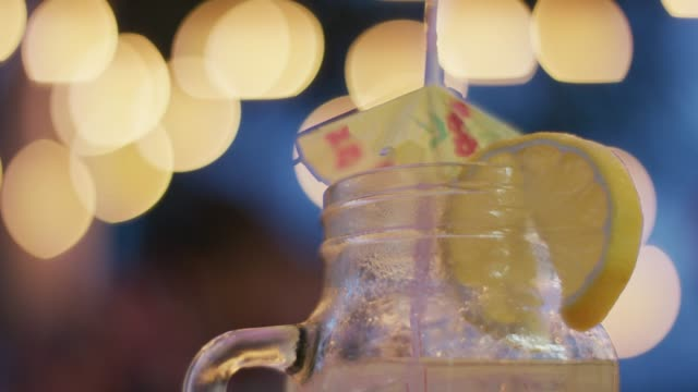 closeup of a glass of lemonade with a tiny umbrella - traditional lemonade stock videos & royalty-free footage