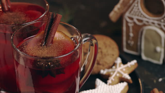 close-up of a glass of mulled wine sprinkled with ground cinnamon - scented stock videos & royalty-free footage