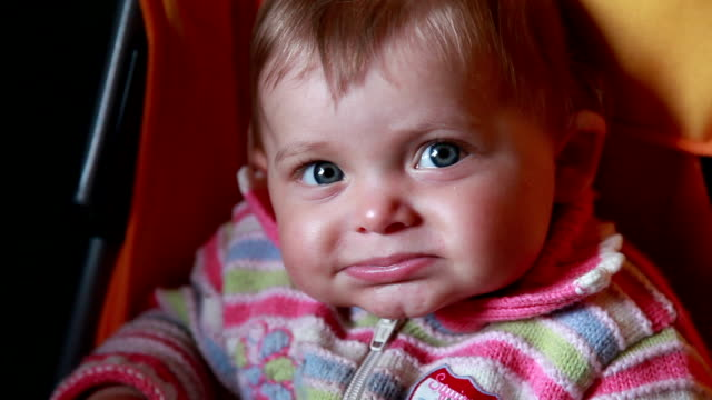 Close-up of a guilty baby lowering her eyes