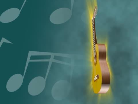 vídeos y material grabado en eventos de stock de close-up of a guitar spinning - guitarra