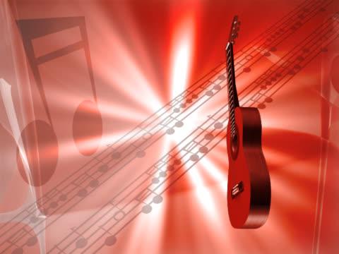 vídeos de stock, filmes e b-roll de close-up of a guitar spinning - desaparecer gradualmente