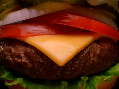 a close-up of a hamburger - artbeats stock videos & royalty-free footage