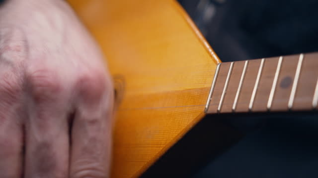 close-up of a hand playing a balalaika. - national landmark stock videos & royalty-free footage