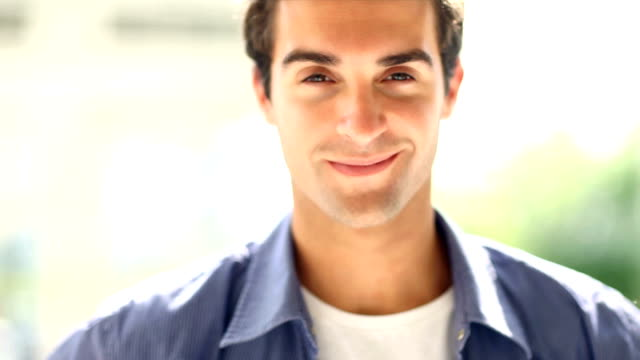Close-up of a handsome young man smiling