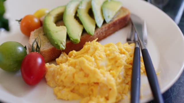 close-up of a healthy breakfast - avocado salad stock videos & royalty-free footage