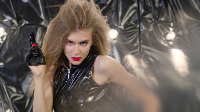 close-up of a high fashion model`s face in stage make-up. model holds red lipstick and plays with it. fashion video. - greasepaint stock videos and b-roll footage
