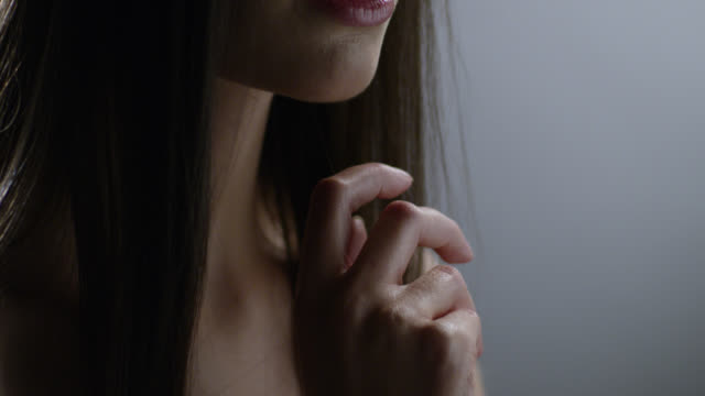close-up of a high fashion model`s hand, lips, neck and clavicle. fashion video. - straight hair stock videos & royalty-free footage
