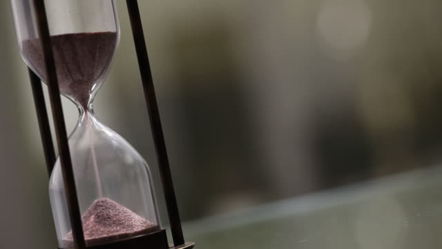 close-up of a hourglass  - hourglass stock videos & royalty-free footage