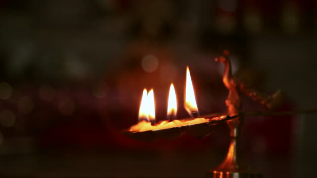 close-up of a lamp burning  - oil lamp stock videos & royalty-free footage