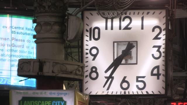 Closeup of a large square clock in Chhatrapati Shivaji Terminus Mumbai showing the time twentyfive to eight Maharashtra India FKAD675A Clip taken...