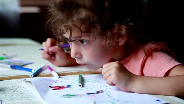 close-up of a little girl drawing a picture - human face drawing stock videos & royalty-free footage