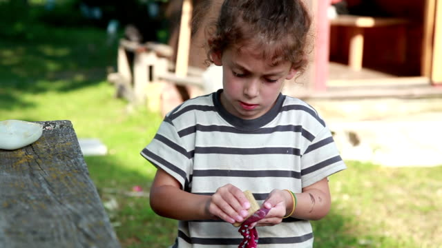 close-up of a little girl rubbing dirty socks with a bar of soap in the backyard - bar of soap stock videos & royalty-free footage
