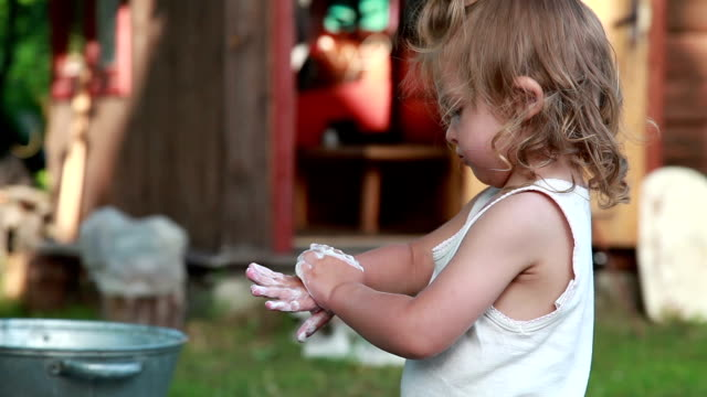 close-up of a little girl washing hands - soap sud stock videos & royalty-free footage
