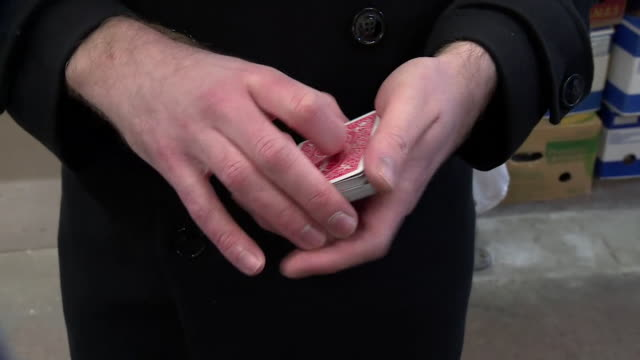 close-up of a magician shuffling cards - magic trick stock videos & royalty-free footage