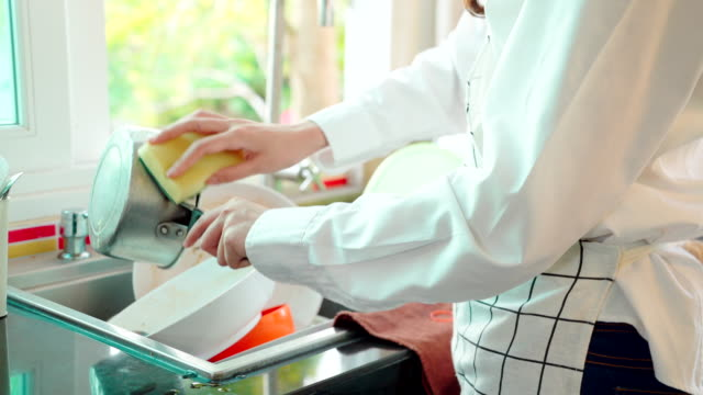 closeup of a maid washing dishes or doing housework. - foam stock videos & royalty-free footage