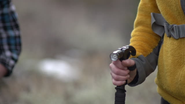 close-up of a man and woman holding hiking poles. - wanderstock stock-videos und b-roll-filmmaterial