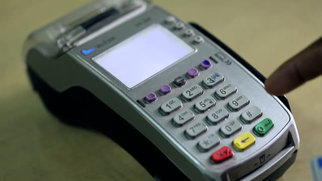close-up of a man hand making a credit card payment - spending money stock videos & royalty-free footage