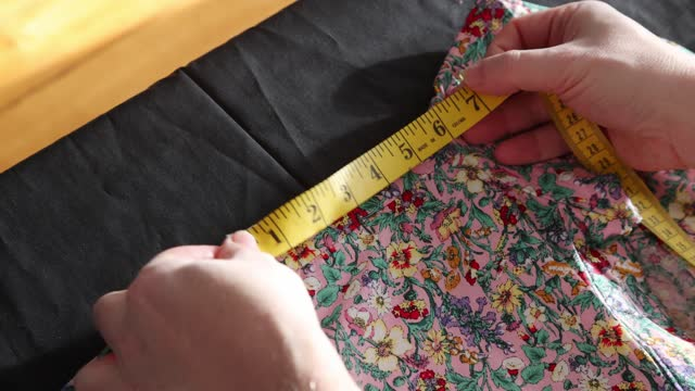 close-up of a man measuring the length of a shirt shoulder - tape measure stock videos & royalty-free footage