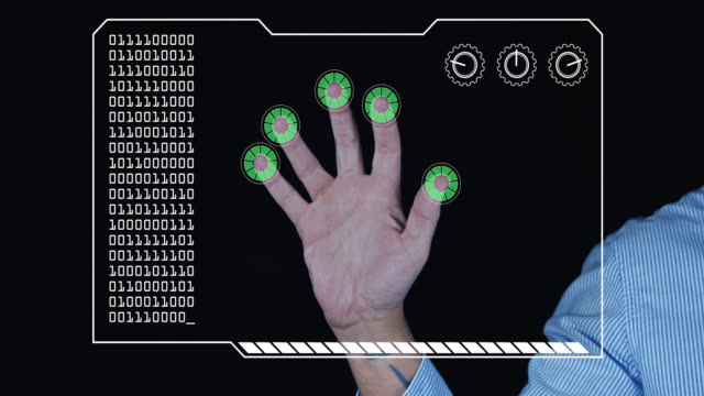 Close-up of a man's hand with HUD scanning graphic overlay finishing with green 'permission granted' finger trackers.