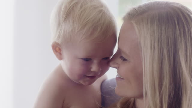 close-up of a mother loving her baby boy - baby boys stock videos and b-roll footage