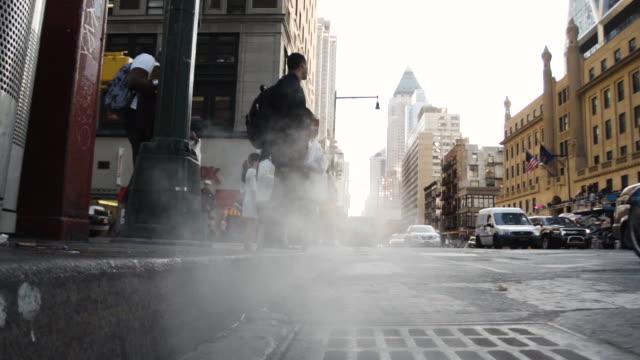 a closeup of a new york city intersection. - schmutzig stock-videos und b-roll-filmmaterial