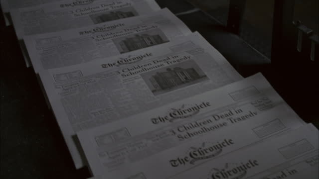 close-up of a newspaper printing press printing copies of a news sheet. - pushing stock videos & royalty-free footage