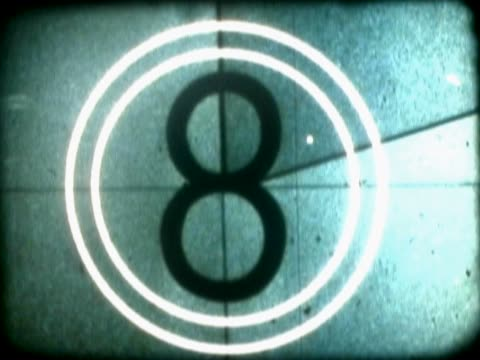 close-up of a number countdown on a film leader - 数字の6点の映像素材/bロール