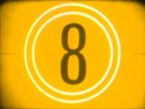 close-up of a number countdown on a film leader - アルファベット点の映像素材/bロール