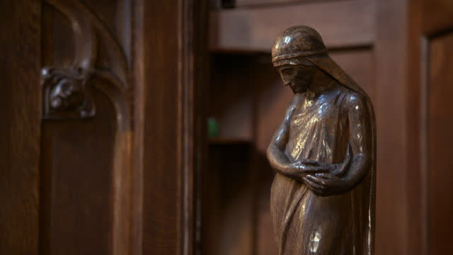close-up of a old bronze statue inside glasgow cathedral - cathedral stock videos & royalty-free footage