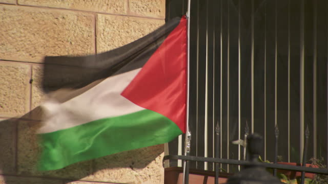 closeup of a palestinian flag flying in ramallah in the west bank - palestinian flag stock videos & royalty-free footage