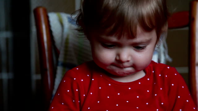 close-up of a pensive baby looking down - sticking out tongue stock videos & royalty-free footage