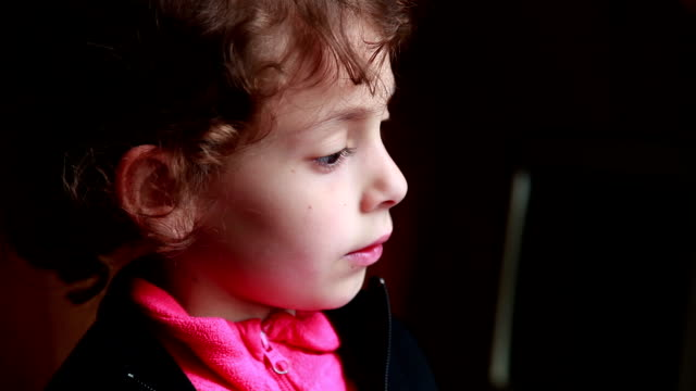 close-up of a pensive little girl daydreaming - high contrast stock videos & royalty-free footage