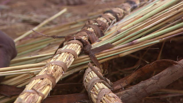 close-up of a person making a thatched roof - thatched roof stock videos & royalty-free footage