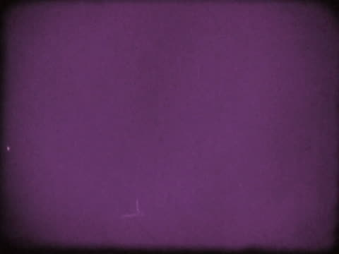 close-up of a purple film leader - ビネット点の映像素材/bロール