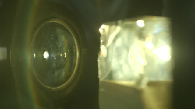close-up of a 'rainbow' created by white light being shone through a convex glass lens and a glass prism. - magnifying glass stock videos & royalty-free footage
