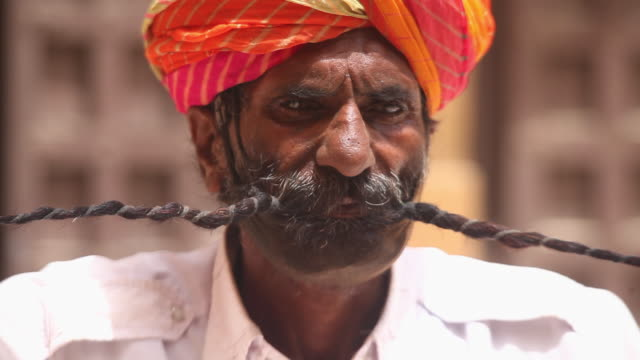 close-up of a rajasthani man showing his large moustache, rishikesh, uttarakhand, india - moustache stock videos & royalty-free footage