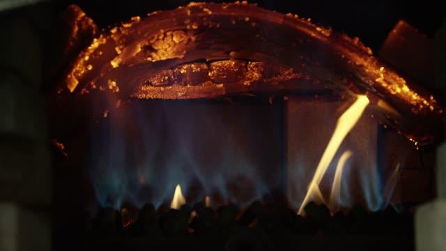 close-up of a roaring hot fire underneath a rum distillery still - distillery still stock videos & royalty-free footage