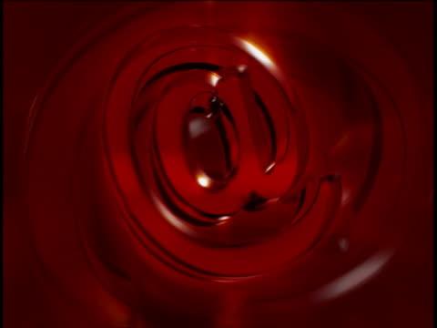 close-up of a rotating 'at' symbol - 'at' symbol stock videos and b-roll footage