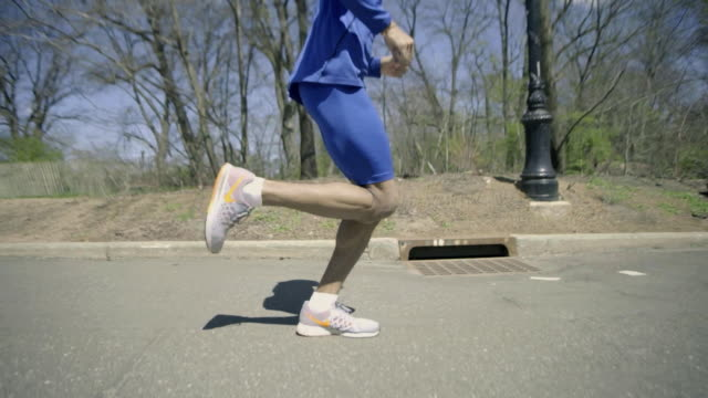 closeup of a runner's legs. - striding stock videos & royalty-free footage