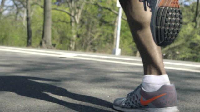 Closeup of a runner's legs.