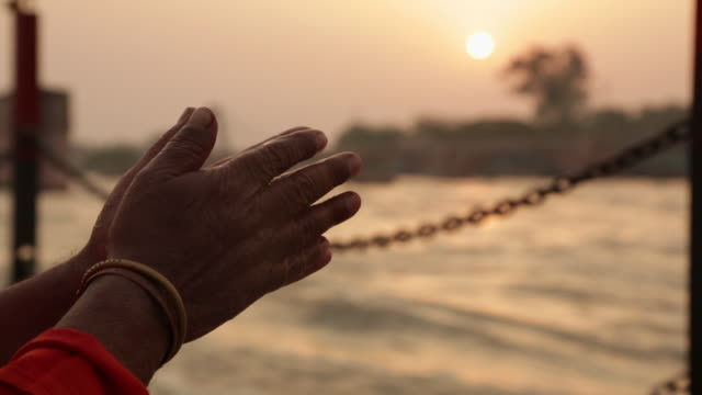 close-up of a sage's hands worshipping at riverbank, ganges river, haridwar, uttarakhand, india - less than 10 seconds stock videos & royalty-free footage
