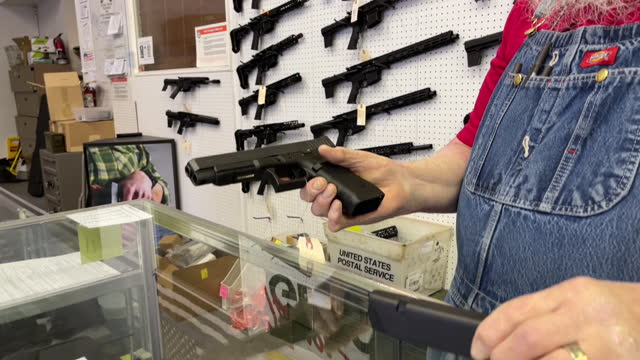 close-up of a salesman presenting a glock handgun at a store in orem, utah, u.s. on thursday, march 25, 2021 . sales and orders of ar-15s and other... - orem utah stock videos & royalty-free footage