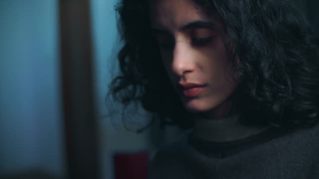 close-up of a serene young woman contemplates deeply. - distrarre lo sguardo video stock e b–roll