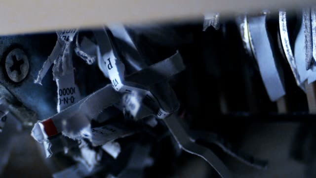 stockvideo's en b-roll-footage met close-up of a shredder machine shredding paper - dossier