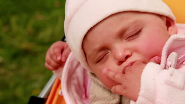 Close-up of a sleeping baby nodding off