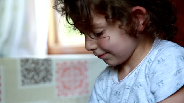 close-up of a smiling child shrugging shoulders - shrugging stock videos and b-roll footage