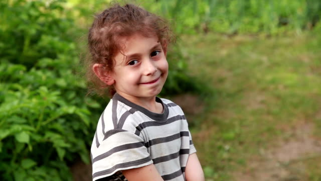 close-up of a smiling little girl getting sad - frowning stock videos & royalty-free footage