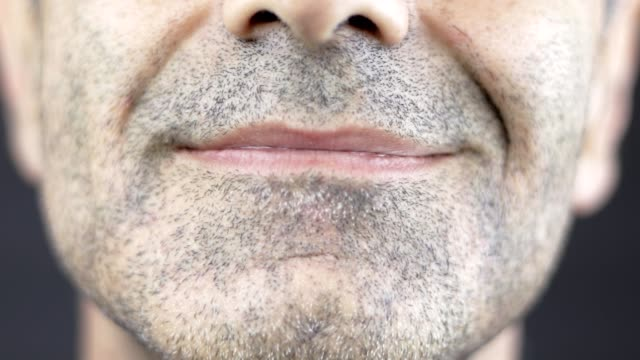 closeup of a smiling man, expression changing from neutral to smiling - 40 44 years stock videos & royalty-free footage