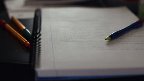 close-up of a spiral notebook and a pen on the living room table - pen stock videos & royalty-free footage